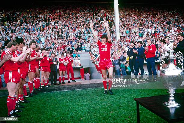 Alan Hansen captain of Liverpool acknowledges the appreciation of the Anfield crowd and his teammates as he steps out for his testimonial game in...