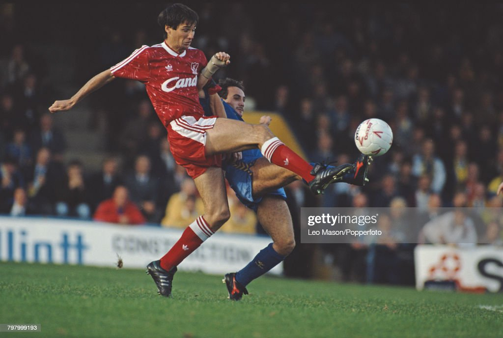 Alan Hansen of Liverpool (left) and Terry Gibson of Wimbledon clash for the ball during a League Division One game between Wimbledon and Liverpool at Plough Lane stadium in London on 14th October 1989. Liverpool would go on to win the game 2-1.