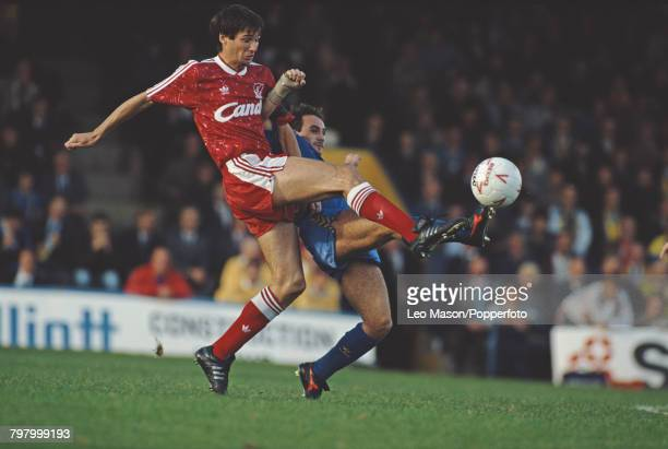 Alan Hansen of Liverpool and Terry Gibson of Wimbledon clash for the ball during a League Division One game between Wimbledon and Liverpool at Plough...