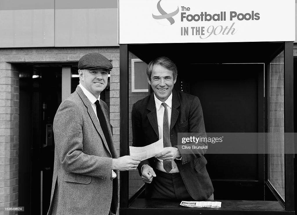 Alan Hansen poses with Gary Pallister wearing 1920's period outfits during a Football Pools photo call to launch their 90th anniversary 'In the 90th' campaign at Old Trafford on October 8, 2012 in Manchester, England. The first Football Pools coupon was sold to football fans outside Old Trafford 90 years ago.