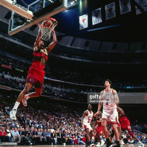 Alan Henderson of the Atlanta Hawks dunks the ball during the game against the Chicago Bulls on May 8 1997 at the United Center in Chicago IL NOTE TO...