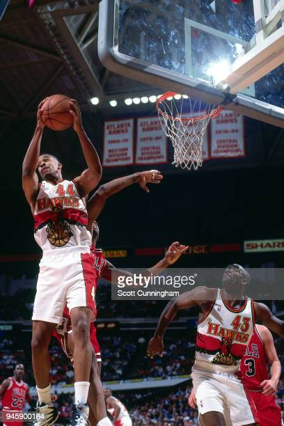 Alan Henderson of the Atlanta Hawks grabs the rebound against the Chicago Bulls on February 22 1996 at the Omni Coliseum in Atlanta Georgia NOTE TO...