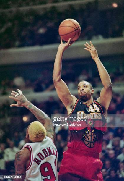 Alan Henderson,Power Forward, Center and Small Forward for the Atlanta Hawks attempts the jump shot over Dennis Rodman of the Chicago Bulls during...