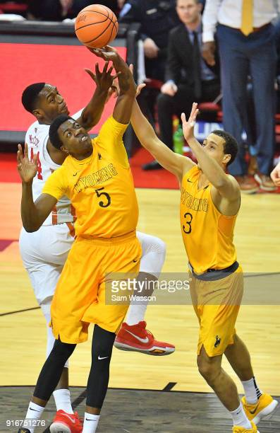Alan Herndon and Alexander Aka Gorski of the Wyoming Cowboys battle for a rebound against Brandon McCoy of the UNLV Rebels during their game at the...