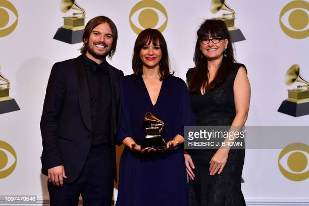 Alan Hicks Rashida Jones and Paula DuPré Pesmen for Best Music Film pose in the press room during the 61st Annual Grammy Awards on February 10 in Los...