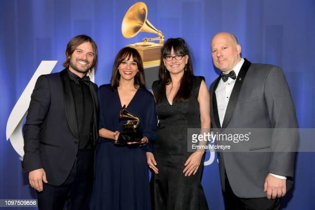 Alan Hicks Rashida Jones Paula DuPré Pesmen and John Poppo pose backstage at the 61st Annual GRAMMY Awards Premiere Ceremony at Microsoft Theater on...