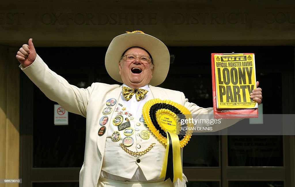 Alan 'Howling Laud' Hope, Leader of the Monster Raving Loony Party, emerges from the West Oxfordshire District Council offices after declaring his intention to run for parliament in Witney, Oxfordshire, on April 19, 2010. Hope is running against David Cameron, leader of the Conservative Party for the constituency political seat. AFP PHOTO/Adrian Dennis