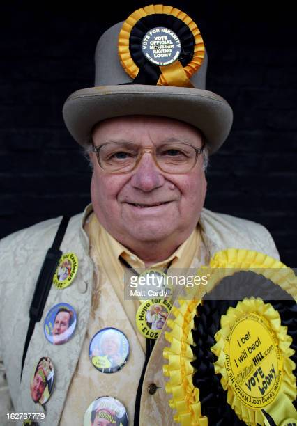 Alan 'Howling Laud' Hope of the Monster Raving Loony Party poses for a photograph as he campaigns for the forthcoming by-election outside the UKIP...