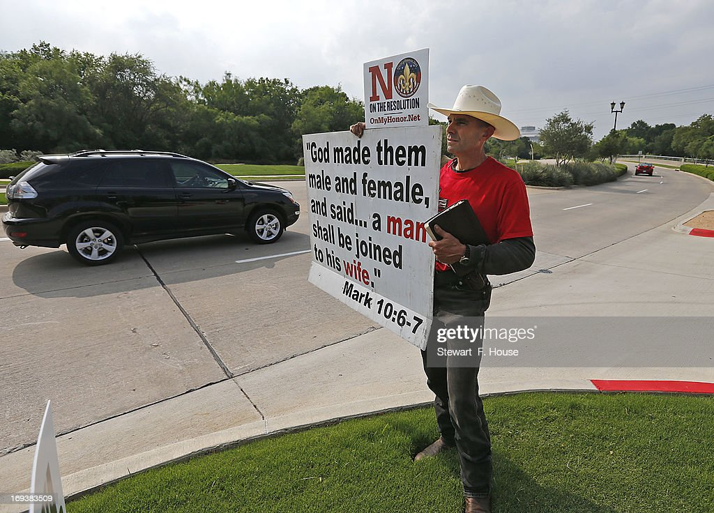 Alan Hoyle, of Lincolnton, North Carolina holds up a sign opposing gays in the Boy Scouts at the Gaylord Texan Resort and Convention Center May 23, 2013 in Grapevine, Texas, The Boy Scouts of America today ended its policy of prohibitting openly gay youths from participating in Scout activities, while leaving intact its ban on gay adults and leaders.