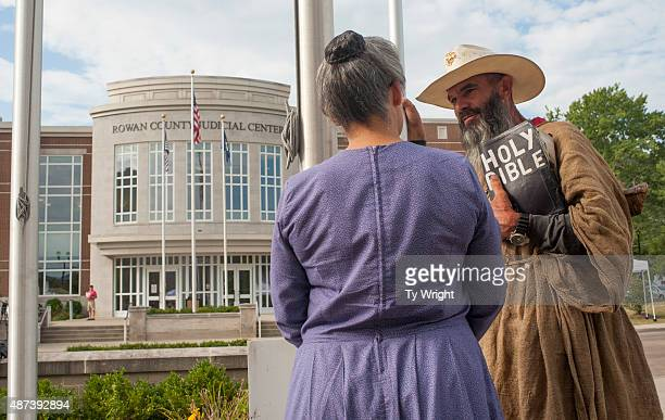 Alan Hoyle of North Carolina holds his bible and while he speaks with a woman during a protest in front of the Rowan County Courthouse on September 9...