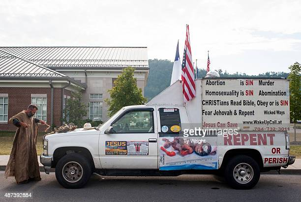 Alan Hoyle of North Carolina stands in front of his mobile protest vehicle in front of Rowan County Courthouse on September 9 2015 in Morehead...
