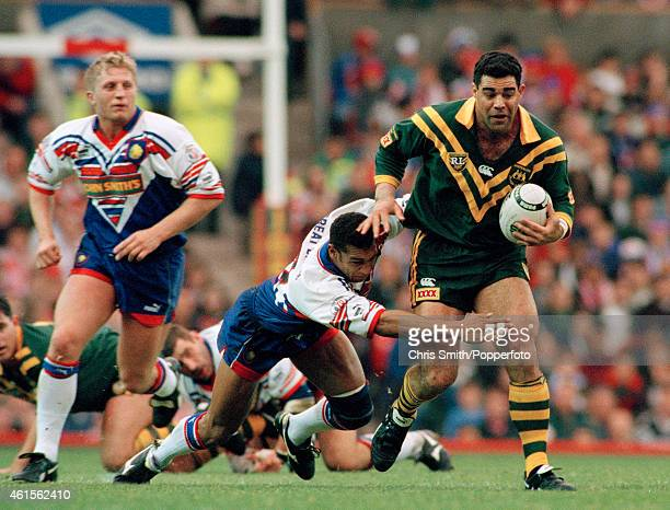 Alan Hunte of Great Britain fails to stop Mal Meninga of Australia with Denis Betts looking on during the 2nd Test Match between Great Britain and...