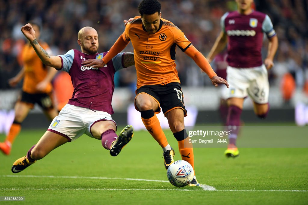 Alan Hutton of Aston Villa and Helder Costa of Wolverhampton Wanderers during the Sky Bet Championship match between Wolverhampton and Aston Villa at Molineux on October 14, 2017 in Wolverhampton, England.