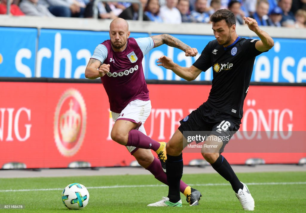 Alan Hutton of Aston Villa and Lukas Froede of MSV Duisburg during the game between Aston Villa and the MSV Duisburg on July 23, 2017 in Duisburg, Germany.
