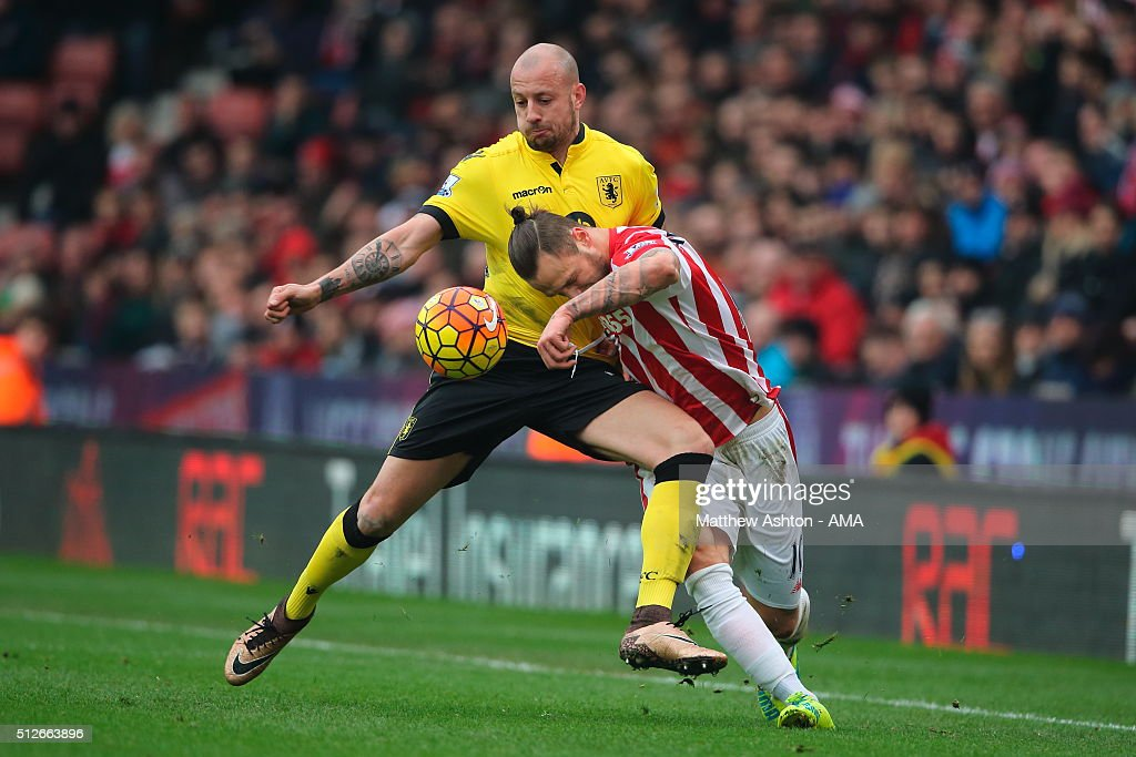 Alan Hutton of Aston Villa and Marko Arnautovic of Stoke City during the Barclays Premier League match between Stoke City and Aston Villa at the Britannia Stadium on February 27, 2016 in Stoke-on-Trent, England.