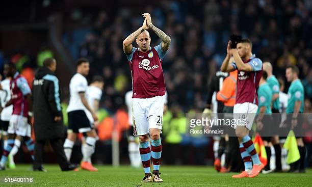 Alan Hutton of Aston Villa applauds the crowd after the Barclays Premier League match between Aston Villa and Tottenham Hotspur at Villa Park on...
