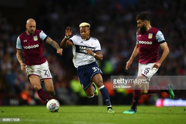 Alan Hutton of Aston Villa battles for possession with Adama Traore of Middlesbrough and Mile Jedinak of Aston Villa during the Sky Bet Championship...
