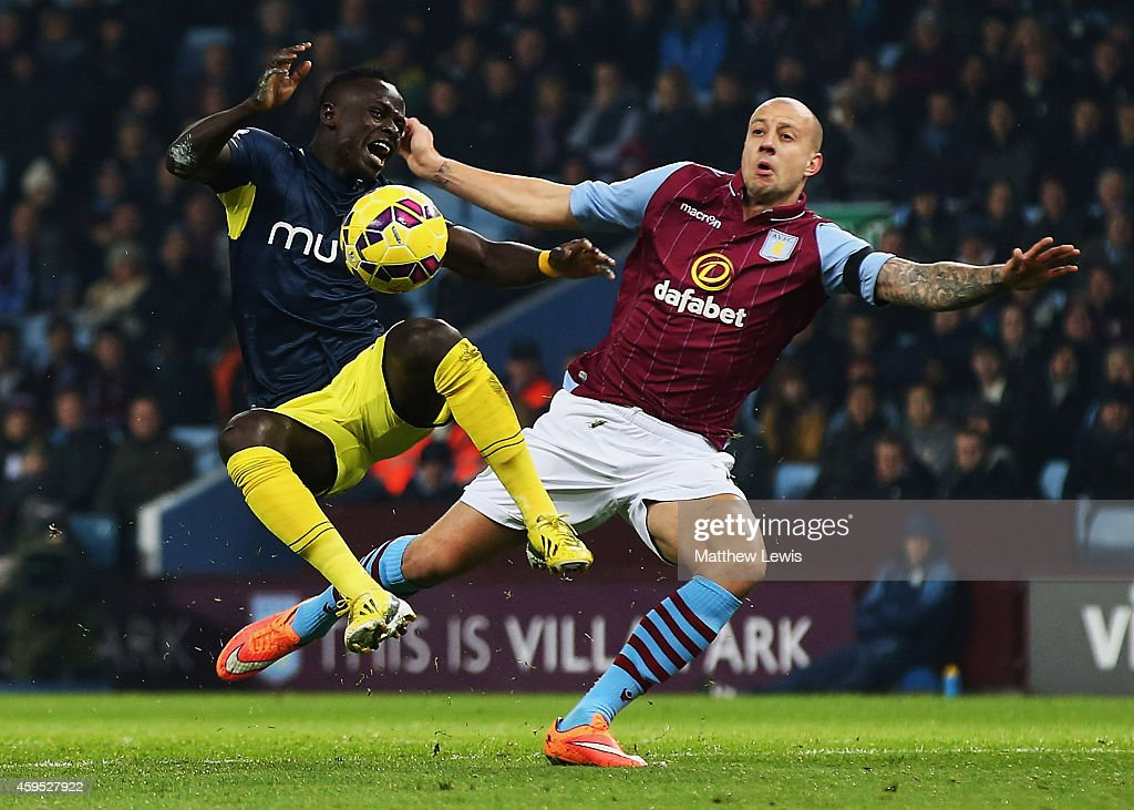 Alan Hutton of Aston Villa battles with Sadio Mane of Southampton during the Barclays Premier League match between Aston Villa and Southampton at Villa Park on November 24, 2014 in Birmingham, England.
