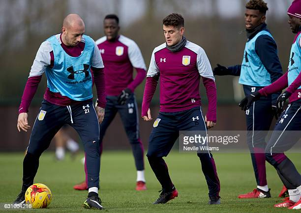 Alan Hutton of Aston Villa during a training session with team mate Ashley Westwood at the club's training ground at Bodymoor Heath on January 13...