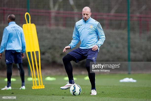 Alan Hutton of Aston Villa in action during a Aston Villa training session at the club's training ground at Bodymoor Heath on March 05 2015 in...