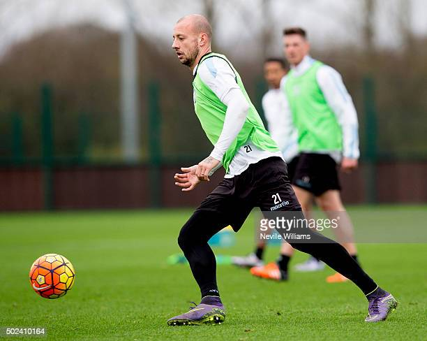 Alan Hutton of Aston Villa in action during a Aston Villa training session at the club's training ground at Bodymoor Heath on December 24 2015 in...