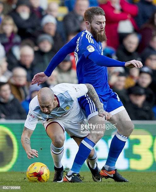Alan Hutton of Aston Villa is challenged by Aron Gunnarsson of Cardiff City during the Sky Bet Championship match between Cardiff City and Aston...