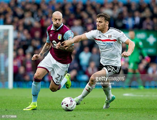Alan Hutton of Aston Villa is challenged by Chris Martin of Fulham during the Sky Bet Championship match between Aston Villa and Fulham at Villa Park...