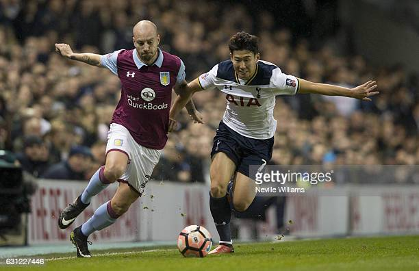 Alan Hutton of Aston Villa is challenged by Heung Min Son of Tottenham Hotspur during the FA Cup Third Round match between Tottenham Hotspur and...