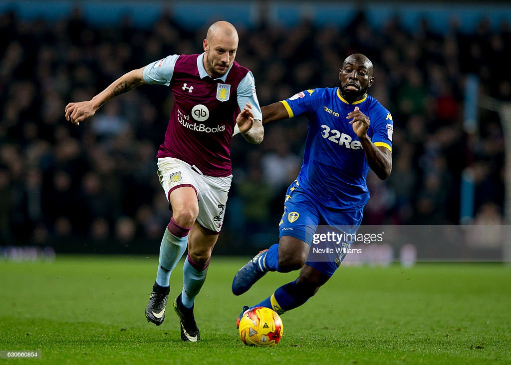 Alan Hutton of Aston Villa is challenged by Souleymane Doukara of Leeds United during the Sky Bet Championship match between Aston Villa and Leeds United at Villa Park on December 29, 2016 in Birmingham, England.