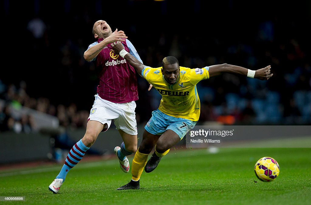 Alan Hutton of Aston Villa is challenged by Yannick Bolasie of Crystal Palace during the Barclays Premier League match between Aston Villa and Crystal Palace at Villa Park on January 01, 2015 in Birmingham, England.