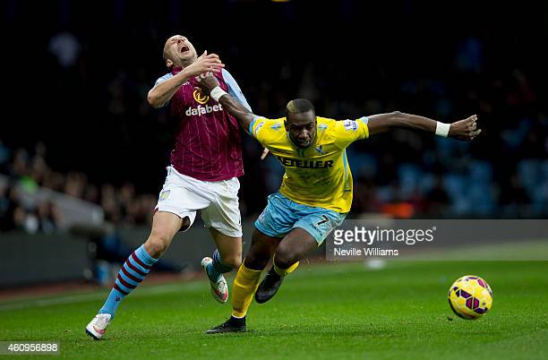 Alan Hutton of Aston Villa is challenged by Yannick Bolasie of Crystal Palace during the Barclays Premier League match between Aston Villa and...