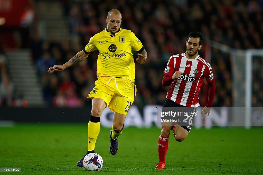 Alan Hutton of Aston Villa is chased by Juanmi of Southampton during the Capital One Cup Fourth Round match between Southampton v Aston Villa at St Mary's Stadium on October 28, 2015 in Southampton, England.