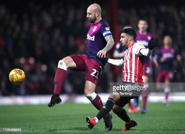 Alan Hutton of Aston Villa is closed down by Said Benrahma of Brentford during the Sky Bet Championship match between Brentford and Aston Villa at...