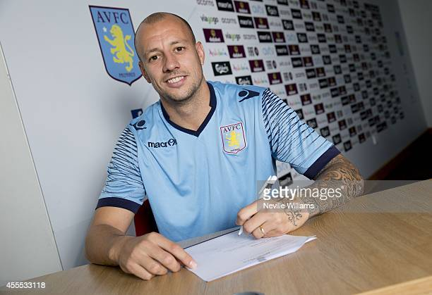 Alan Hutton of Aston Villa poses for a picture after signing a new contract at Aston Villa's training ground at Bodymoor Heath on September 16 2014...