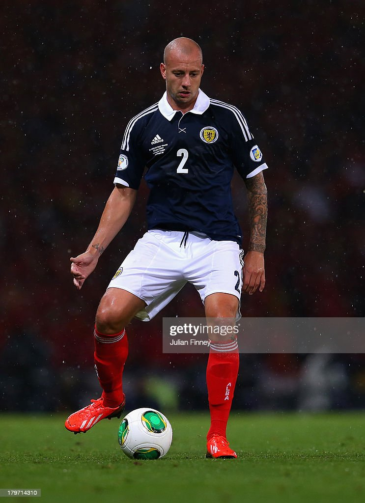 Alan Hutton of Scotland in action during the FIFA 2014 World Cup Qualifying Group A match between Scotland and Belgium at Hampden Park on September 6, 2013 in Glasgow, Scotland.