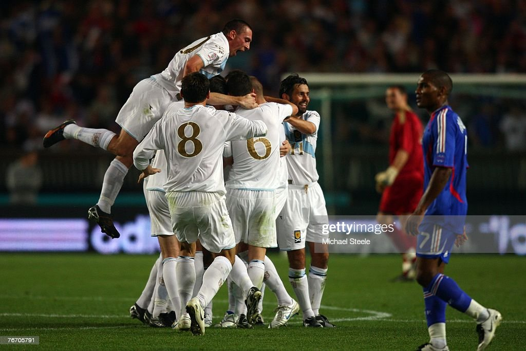 Alan Hutton of Scotland leaps in to celebrate James McFadden on his goal during the Euro 2008 Group B qualifying match between France and Scotland at the Parc de Princes on September 12, 2007 in Paris, France.