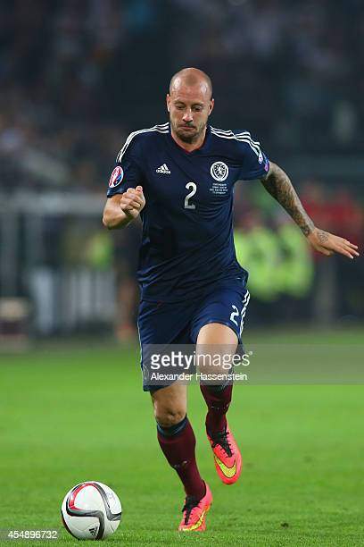 Alan Hutton of Scotland runs with the ball dring the EURO 2016 Group D qualifying match between Germany and Scotland at Signal Iduna Park on...