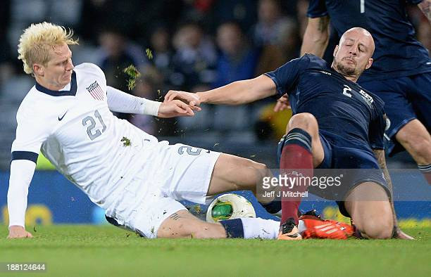 Alan Hutton of Scotland tackles Brek Shea of the USA during the international friendly at Hampden Park on November 15 2013 in Glasgow Scotland