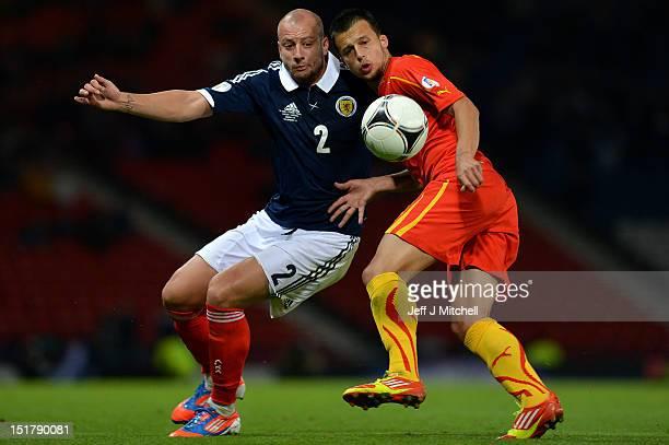 Alan Hutton of Scotland tackles Daniel Georgievskii of Macedonia during the FIFA World Cup Qualifier Between Scotland and Macedonia at Hampden Park...