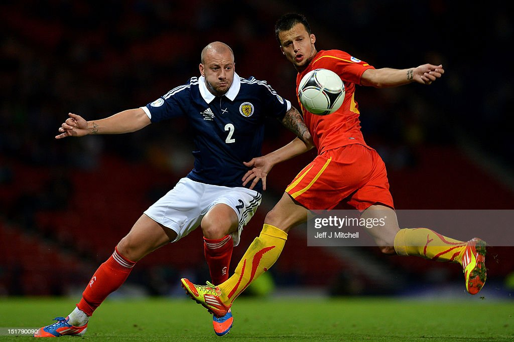 Alan Hutton of Scotland tackles Daniel Georgievskii of Macedonia during the FIFA World Cup Qualifier Between Scotland and Macedonia at Hampden Park on September 11, 2012 in Glasgow, Scotland.