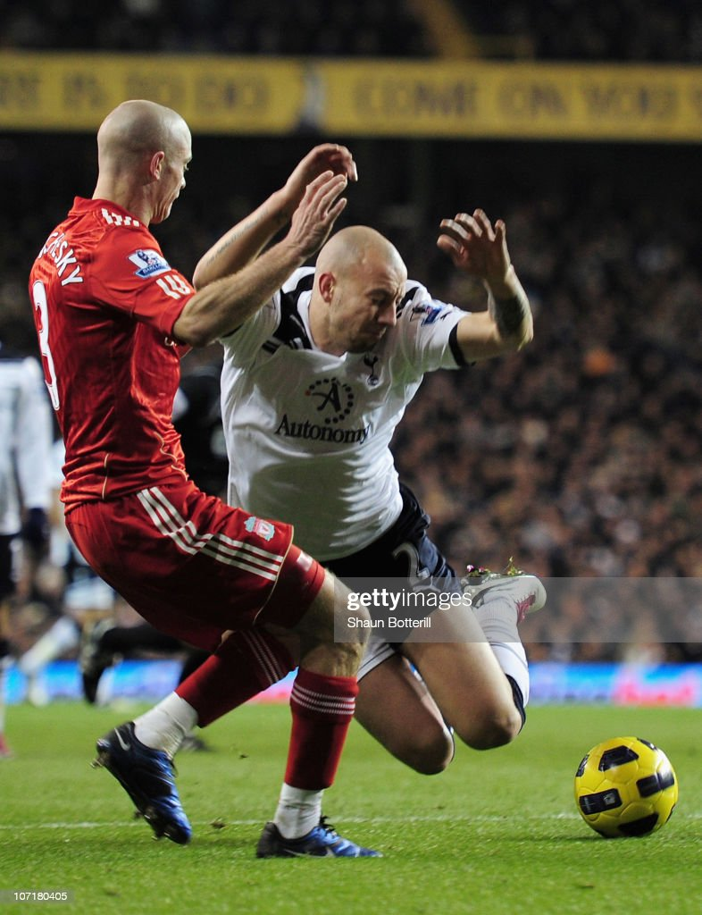 Alan Hutton of Tottenham Hotspur goes down in the penalty area after a tackle by Paul Konchesky of Liverpool during the Barclays Premier League match between Tottenham Hotspur and Liverpool at White Hart Lane on November 28, 2010 in London, England.