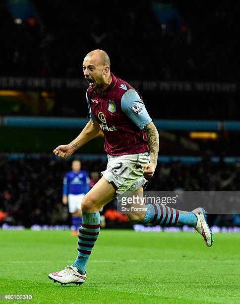 Alan Hutton of Villa celebrates after scoring the second goal during the Barclays Premier League match between Aston Villa and Leicester City at...