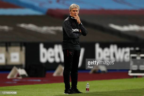Alan Irvine, Coach at West Ham United and temporary manager for the match looks on during the Carabao Cup Third Round match between West Ham United...