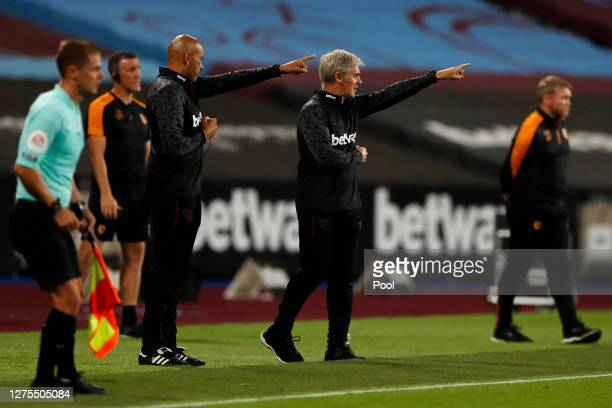 Alan Irvine, Coach at West Ham United and temporary manager for the match gives his team instructions during the Carabao Cup Third Round match...