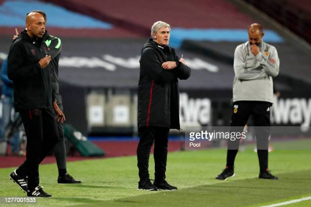 Alan Irvine, coach of West Ham gives his players instructions during the Premier League match between West Ham United and Wolverhampton Wanderers at...