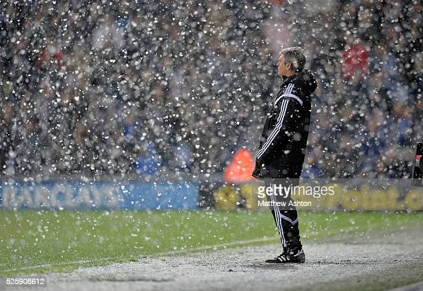 Alan Irvine head coach / manager of West Bromwich Albion watches his team play out a 13 defeat in the snow on Boxing Day