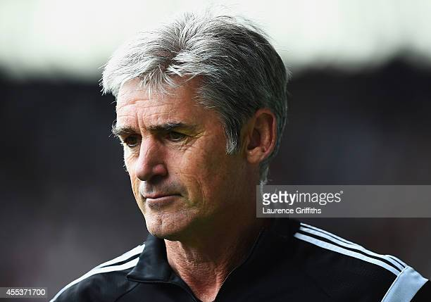 Alan Irvine, manager of West Brom looks on during the Barclays Premier League match between West Bromwich Albion and Everton at The Hawthorns on...