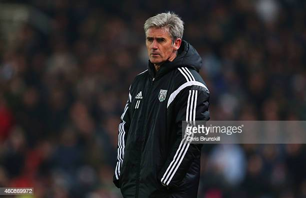 Alan Irvine manager of West Bromwich Albion looks on during the Barclays Premier League match between Stoke City and West Bromwich Albion at...