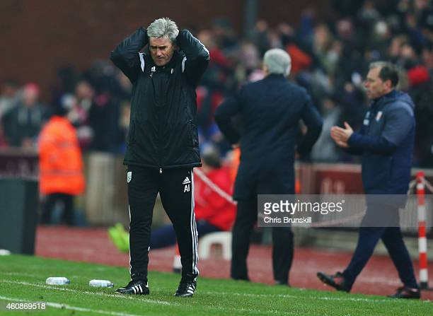 Alan Irvine manager of West Bromwich Albion reacts during the Barclays Premier League match between Stoke City and West Bromwich Albion at Britannia...