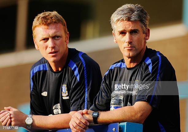 Alan Irvine the coach of Everton looks on with manager David Moyes during the friendly match between Preston North End and Everton at Deepdale on...